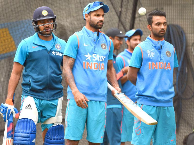Indian batsmen Rohit Sharma (L), Shikhar Dhawan (C) and Ajinkya Rahane (R) stand in the nets during a training session ahead of their 2015 Cricket World Cup quarter-final match against Bangladesh, in Melbourne on March 18, 2015. (AFP Photo)