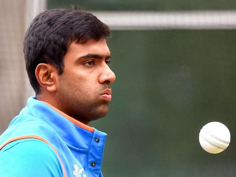 Indian spinner Ravichandran Ashwin prepares to bowl during a training session ahead of their 2015 Cricket World Cup quarter-final match against Bangladesh in Melbourne. (AFP Photo)