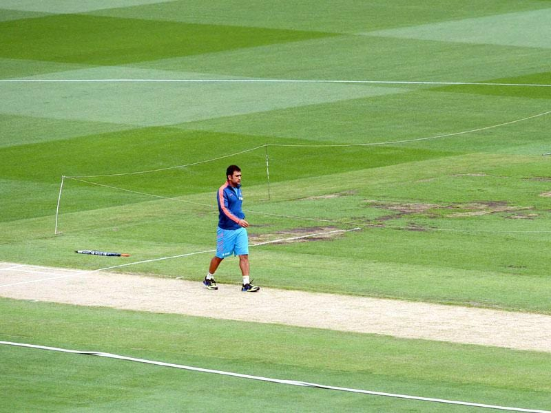 India captain MS Dhoni having a look at the pitch ahead of their quarterfinal match against Bangladesh. (AFP Photo)