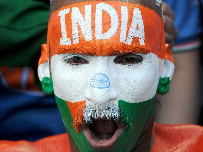 An Indian supporter cheers during the 2015 Cricket World Cup quarter-final match between India and Bangladesh at the Melbourne Cricket Ground (MCG). AFP PHOTO