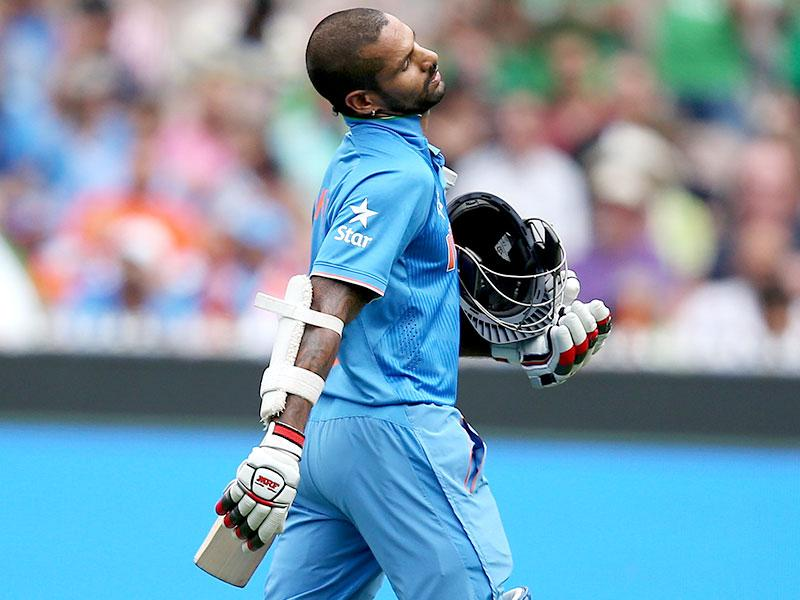 India's Shikhar Dhawan walks from the field after he was out stumped during their Cricket World Cup quarterfinal match against Bangladesh in Melbourne, Australia. (AP Photo)