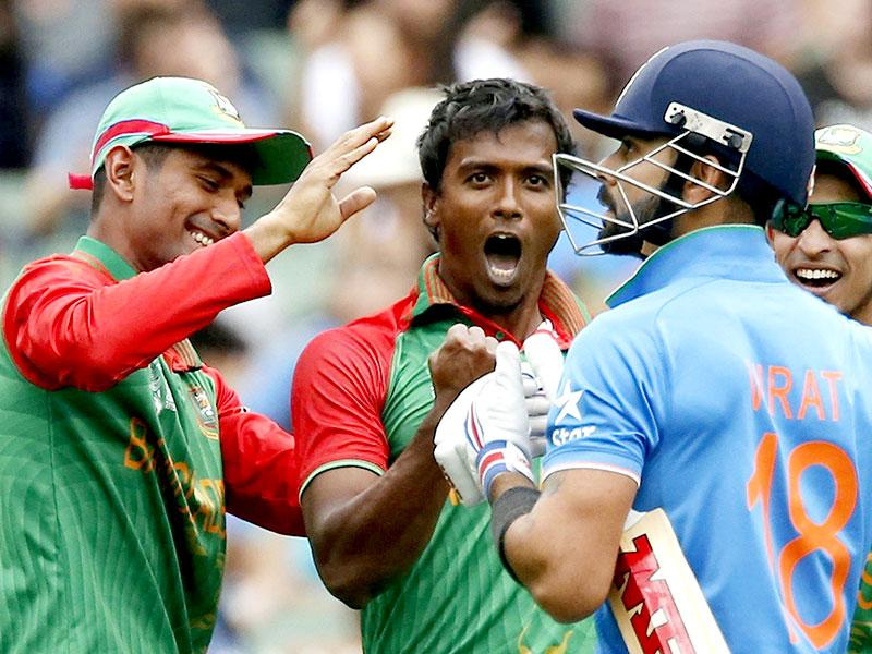 Bangladesh's bowler Rubel Hossain celebrates with team-mates after dismissing India's Virat Kohli for three runs during their Cricket World Cup quarter-final match in Melbourne.  REUTERS
