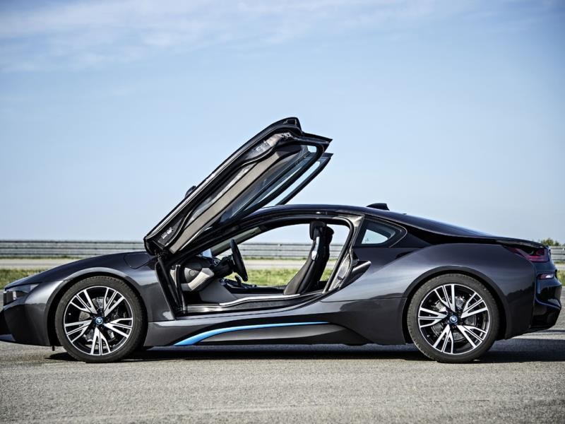 The BMW i8 : Like the McLaren, this car is built out of incredibly exotic materials, comes with clever scissor doors and glides from apex to apex. Like the Honda, it uses a combination of electric and petrol power for greater environmental responsibility and better performance. The engines can all come on together for immediate acceleration and to fill in the gaps caused by turbochargers. Photo:AFP
