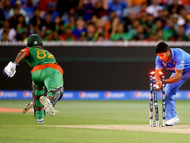India's Umesh Yadav, right, runs out Bangladesh's Imrul Kayes during their Cricket World Cup quarterfinal match in Melbourne, Australia. (AP Photo/Rick Rycroft)