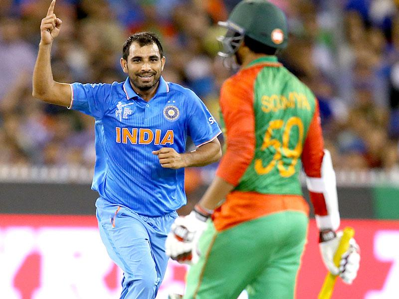 Mohammed Shami celebrates after dismissing Bangladesh's Soumya Sarkar. (AP Photo/Rick Rycroft)
