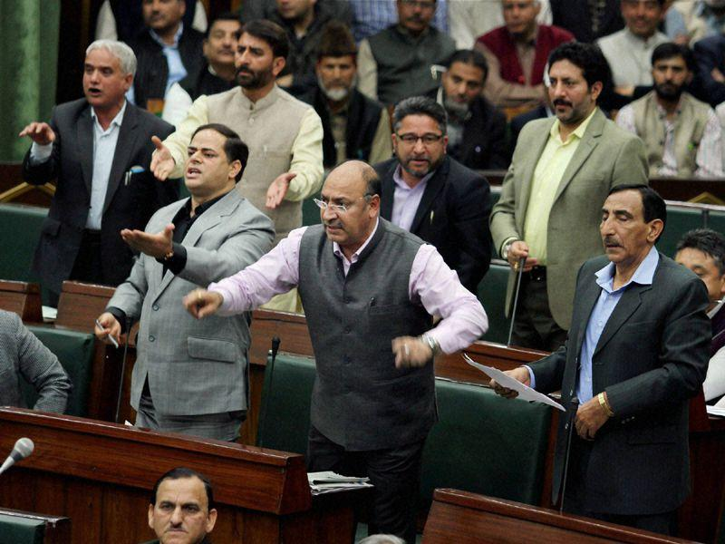 Opposition MLAs protest in the Jammu and Kashmir Assembly during budget session in Jammu on Thursday. PTI Photo