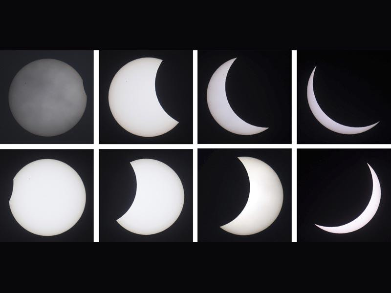 A combo of images showing from clockwise top left the phases of a solar eclipse as seen in Northumberland, England. (AP Photo)