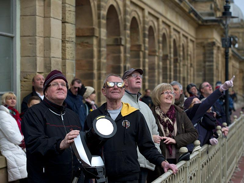 Amateur astronomers and members of the public observe a partial solar eclipse over Scarborough, Northern England. (AFP Photo)