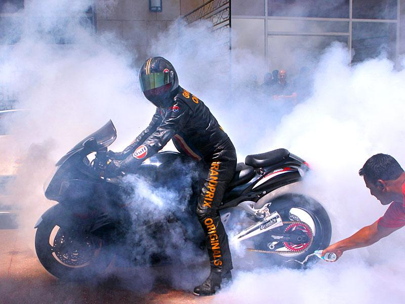 Darren Turner , the winner of 8th FIM European Championship, performs a demo run at the Aston Martin Racing and Drag racing, in Mumbai. (Satish Bate/HT photo)