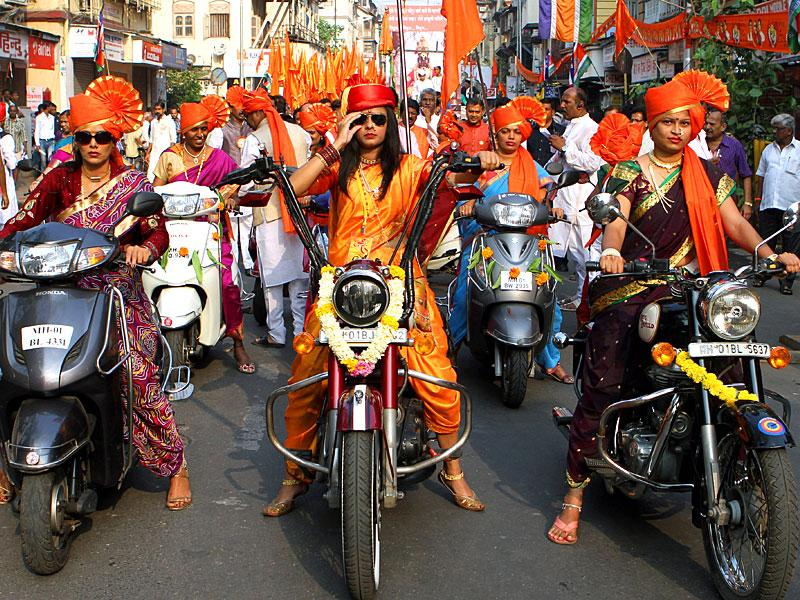 Women dressed in traditional Maharashtrian attire and rode bikes in Mumbai on the occassion of Gudi Padwa, the Maharashtrian new Year. (Arijit Sen/HT photo)