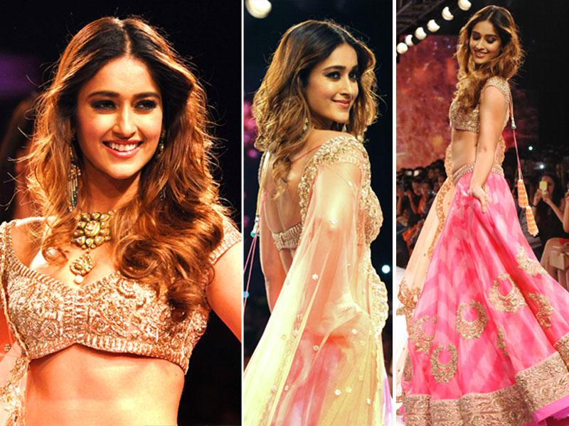 Bollywood actor Ileana D'Cruz walks the runway in a classic and frilly lehenga by designer Anushree Reddy at LFW. (AFP)