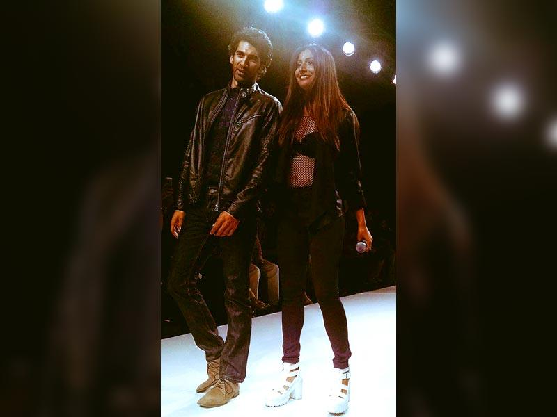 Aditya Roy Kapoor walked the ramp in a black leather jacket-navy blue shirt combo by designer Tom Tailor on Friday. He was accompanied by singer-actor Monica Dogra. (HT Photo)