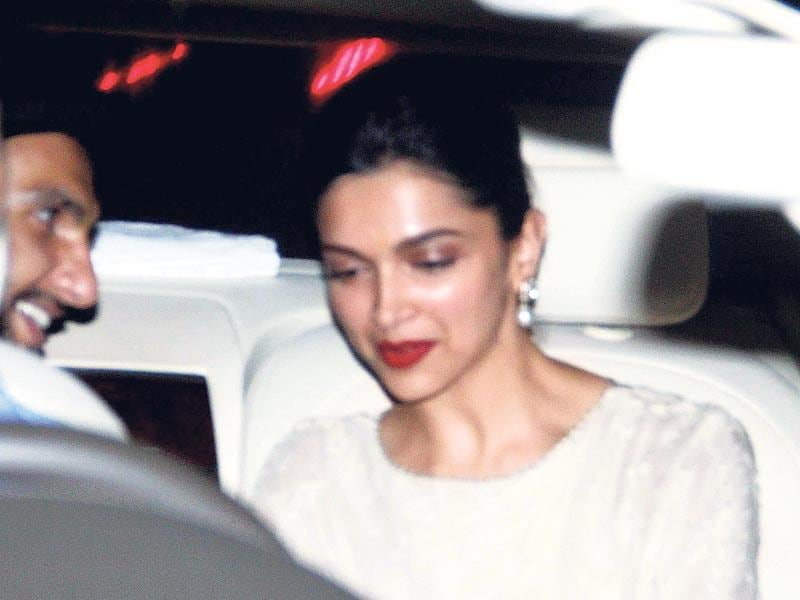 Ranveer Singh and Deepika Padukone share a beautiful moment as their car arrives at the birthday party of producer Karim Morani. (Photo: Viral Bhayani)