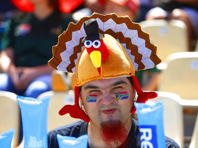 A fan of South Africa's cricket team wears a chicken hat before the start of their Cricket World Cup match against Zimbabwe in Hamilton, February 15, 2015. REUTERS
