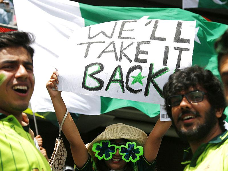 Fans of Pakistan's cricket team cheer in the stands before Pakistan's Cricket World Cup match against India in Adelaide, February 15, 2015. REUTERS