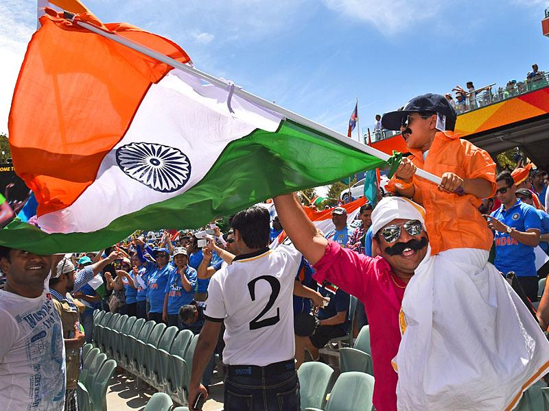 Indian fans cheer on their team during India's match against Pakistan in their 2015 Cricket World Cup match in Adelaide on February 15, 2015. AFP PHOTO