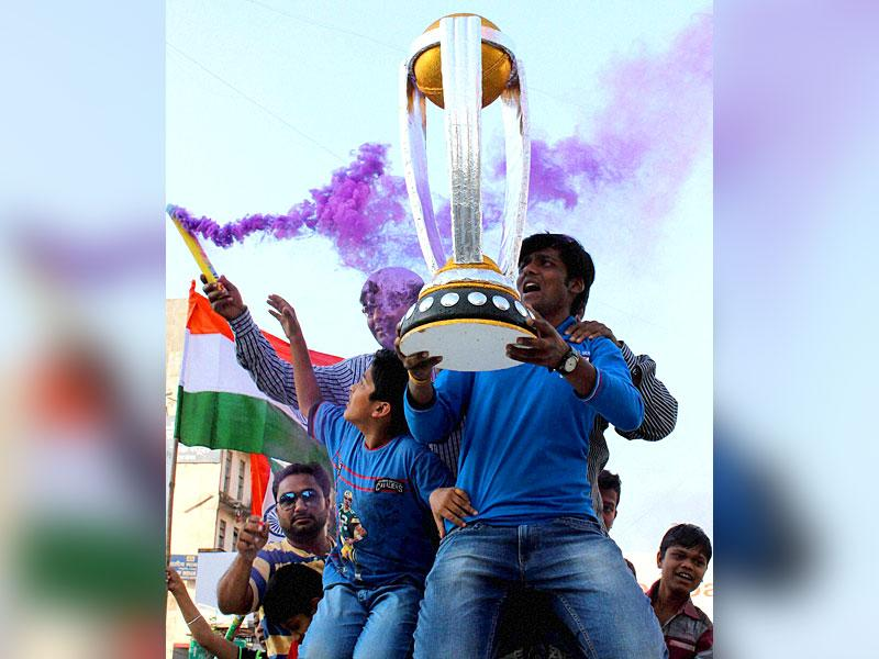 Cricket fans celebrate after team India won their first match against Pakistan in ICC Cricket World Cup, at Lakshmi Bhavan Square in Nagpur, Maharashtra. PTI Photo