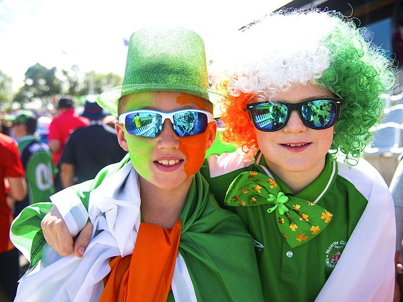 Young Irish fans pose for a photo during the Pool play 2015 Cricket World Cup match between Ireland and the West Indies at Saxton Park Oval in Nelson, New Zealand on February 16, 2015. AFP PHOTO