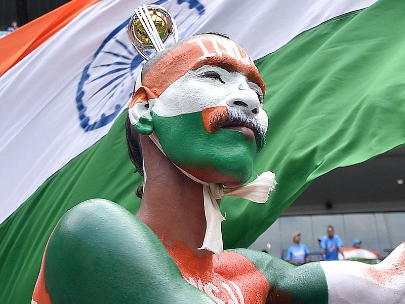 An Indian supporter, with his body painted and a replica trophy atop his head, waits for the start of the Cricket World Cup against South Africa at the Melbourne Cricket Ground (MCG) February 22, 2015. REUTERS