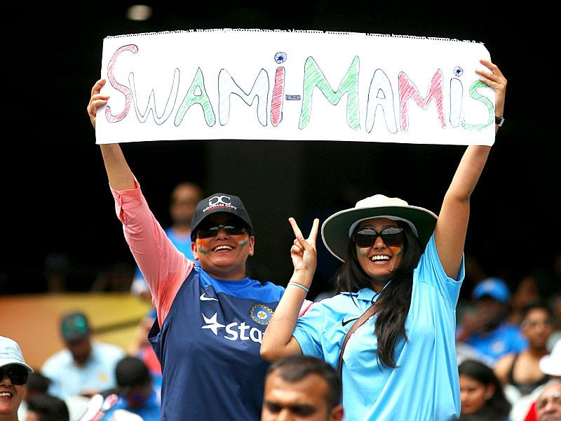 Indian supporters hold banners up ahead of their Cricket World Cup pool B match against South Africa in Melbourne, Australia, Sunday, Feb. 22, 2015. (AP Photo)