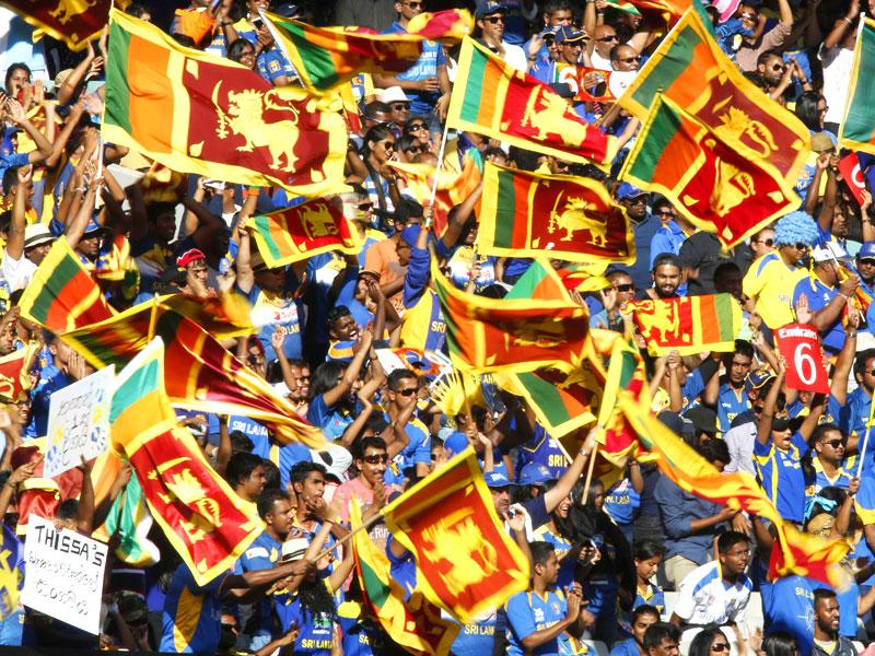 Fans of Sri Lanka's cricket team show their support before their Cricket World Cup match against Bangladesh in Melbourne, February 26, 2015.  REUTERS