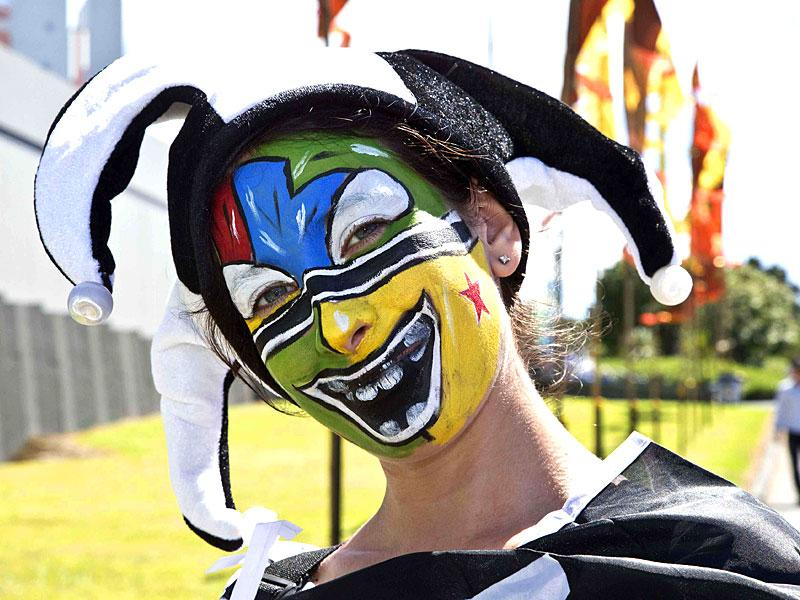 A fan with a painted face is seen outside Eden Park before the Cricket World Cup match between Australia and New Zealand in Auckland February 28, 2015.  REUTERS