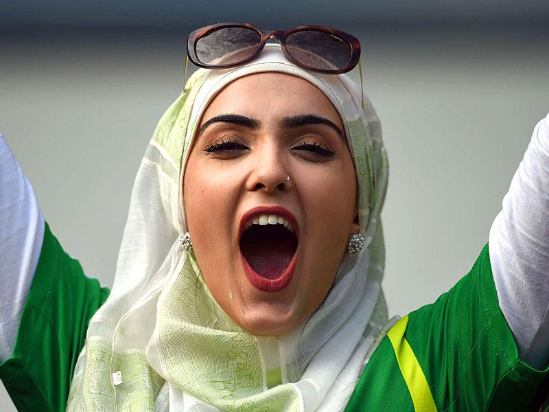 A Pakistan supporter cheers during the 2015 Cricket World Cup Pool B match between Pakistan and Zimbabwe at the Gabba Stadium in Brisbane on March 1, 2015. AFP PHOTO