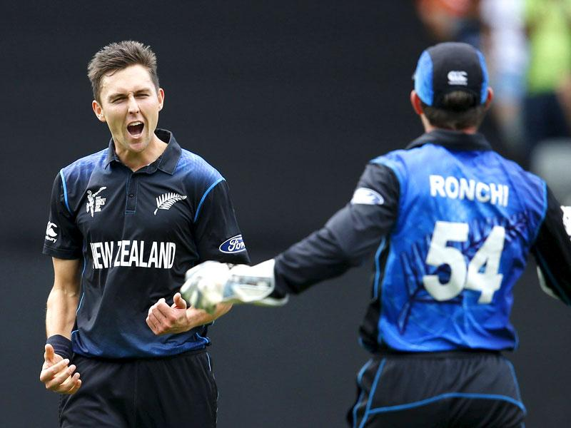 Trent Boult reacts after catching out Quentin de Kock as team mate Luke Ronchi joins him during their Cricket World Cup semi final in Auckland. (Reuters)