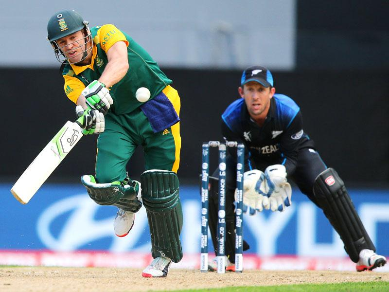 AB de Villiers plays a shot as Luke Ronchi watches during their Cricket World Cup semifinal in Auckland. (AP Photo/David Rowland)