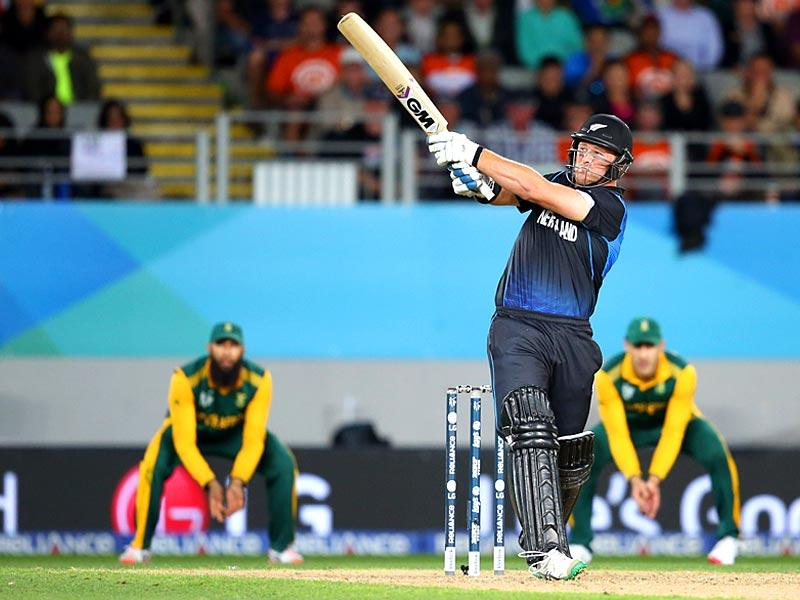 New Zealand's Corey Anderson plays a shot during the semi-final Cricket World Cup match between New Zealand and South Africa played at Eden Park in Auckland. (AFP Photo/Michael Bradley)