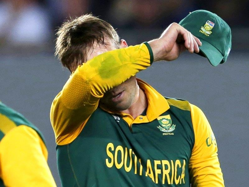 South Africa's captain AB de Villiers reacts after a failed run out attempt on New Zealand's batsman Corey Anderson during their Cricket World Cup semi-final match in Auckland, March 24, 2015. REUTERS