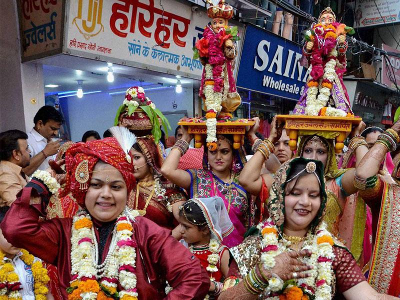 Devotees carry an idol of Gauri during a religious procession taken out on Gangaur festival, in Bhopal on Tuesday. (PTI photo)