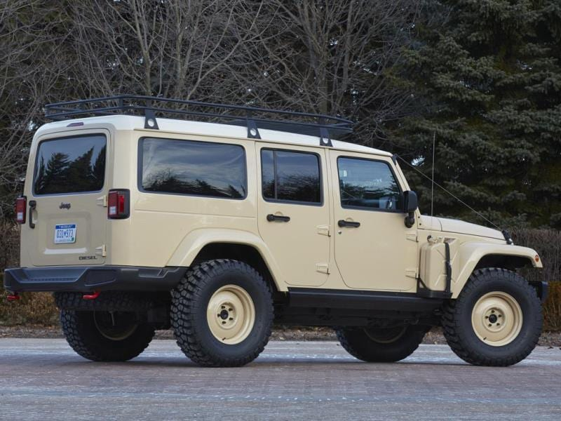 Jeep Wrangler Africa Concept : Conceived as the ultimate go-anywhere SUV, it has a high clearance steel front bumper, rock rails along the sides, an integrated winch and an elongated body, plus raised roof for extra storage and equipment space. It even has externally mounted spare fuel cans. Photo:AFP