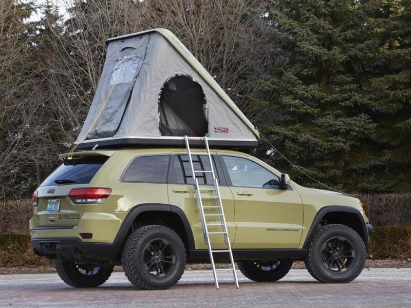 Jeep Grand Cherokee Overlander Concept : A ruggedized version of the company's most comfortable SUV, the Overlander gets a custom front grille, front and rear skid plates, an integrated winch and specially milled 18-inch wheels. The finishing touch is a two-person hard-shell tent on the roof. Photo:AFP