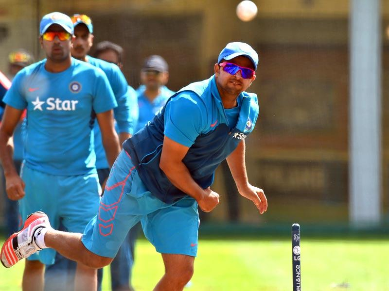 Suresh Raina bowls during a practice session in Sydney. (AFP Photo)