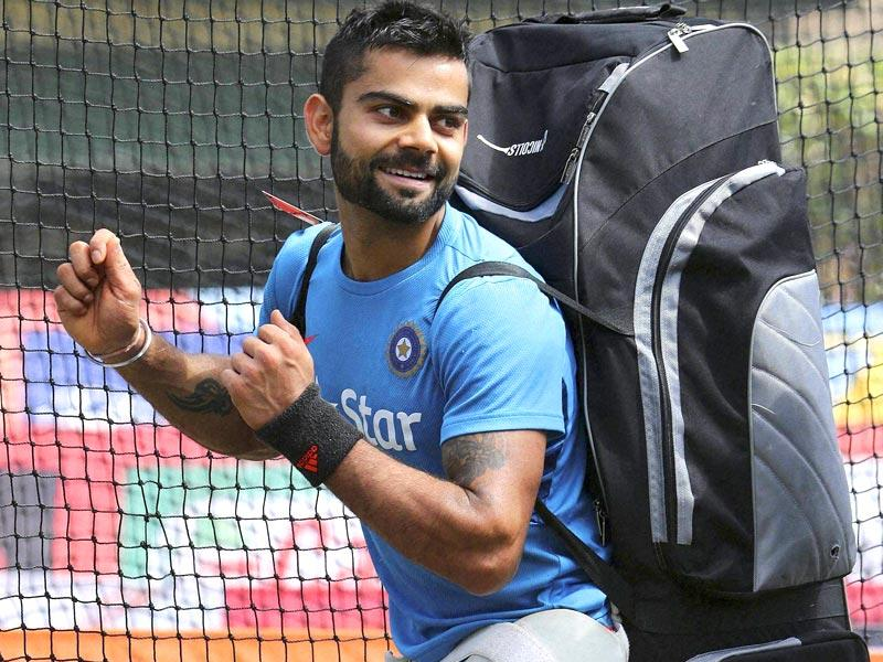 Virat Kohli enjoys a light moment after training for the Cricket World Cup in Sydney. (PTI Photo)
