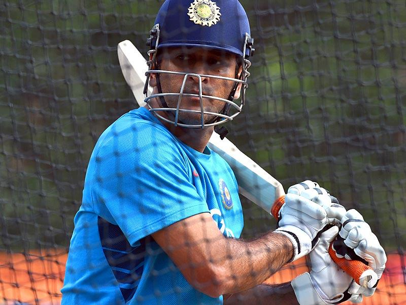 India's captain Mahendra Singh Dhoni bats during a practice session in Sydney. (AFP Photo)