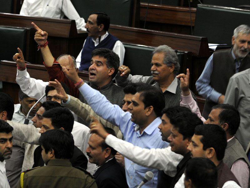 BJP MLAs protesting against National conference MLA Javed Rana remarks against the speaker in House during the budget session, in Jammu. Nitin Kanotra/HT