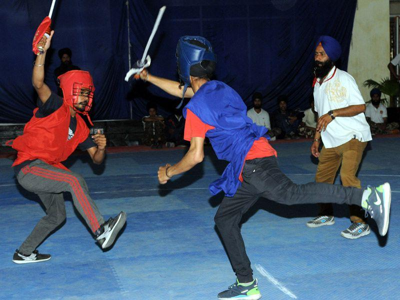 Player in a action during the 3rd all India Gatka competition at Punjabi University in Patiala. Bharat Bhushan/HT