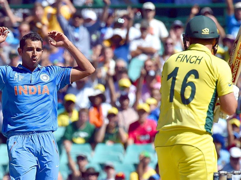 Mohammed Shami reacts after bowling a delivery to Australia's Aaron Finch during the 2015 Cricket World Cup semi-final match at the Sydney Cricket Ground on March 26, 2015. AFP PHOTO