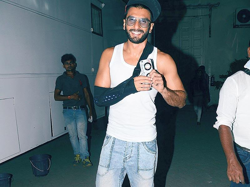That's how being Ranveer Singh feels like! The actor leaves a Bandra (Mumbai) studio post a shoot on Tuesday night. (Photos: Viral Bhayani)