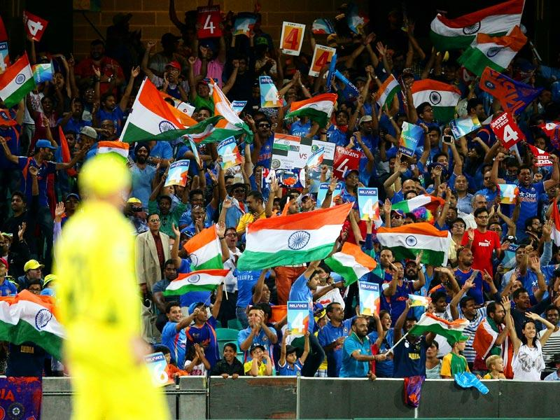 Indian supporters wave their flags as they cheer their team during their Cricket World Cup semifinal against Australia in Sydney, Australia, Thursday, March 26, 2015. (AP Photo)