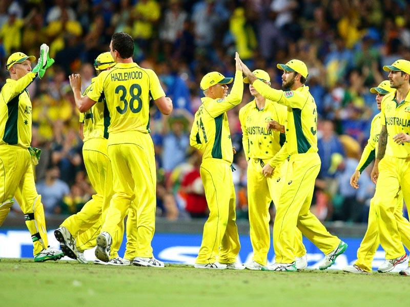 Australian players celebrate after taking the wicket of Shikhar Dhawan during the 2015 World Cup semifinal between Australia and India in Sydney. (AP Photo)