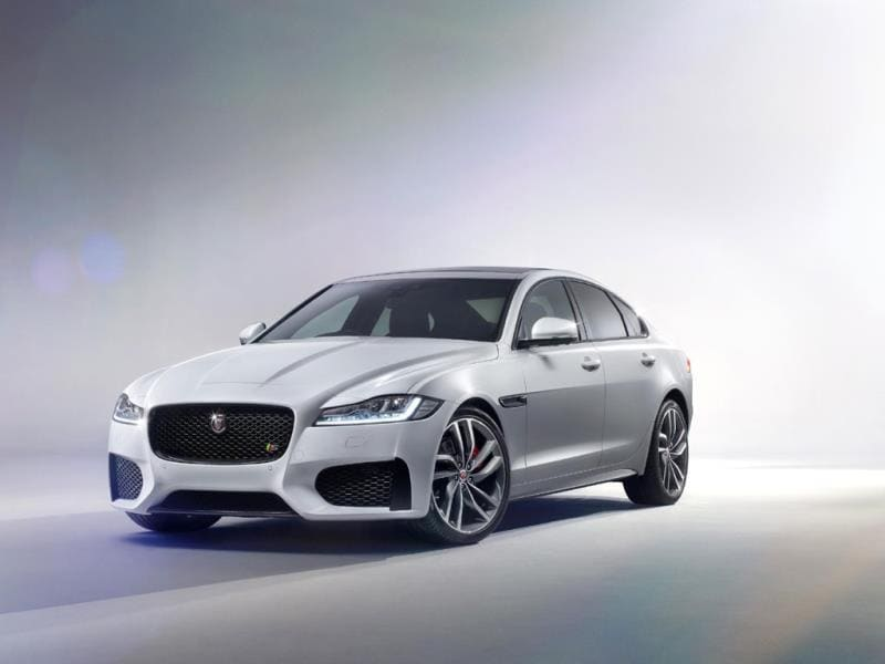 The Jaguar XF : The company won't be publishing in-depth technical data about the car until the New York Auto Show. However, it has confirmed that with its 2-liter turbocharged 160bhp diesel engine, the car boasts a combined cycle fuel economy of more than 70mpg (4l/100km) and at 104g/km its CO2 emissions can only be bettered by a hybrid. Photo:AFP