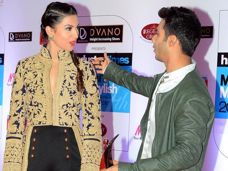Varun Dhawan teases Gauhar Khan as they arrive at the HT Mumbai's Most Stylish Awards 2015 ceremony in Mumbai on March 26, 2015. (AFP Photo)