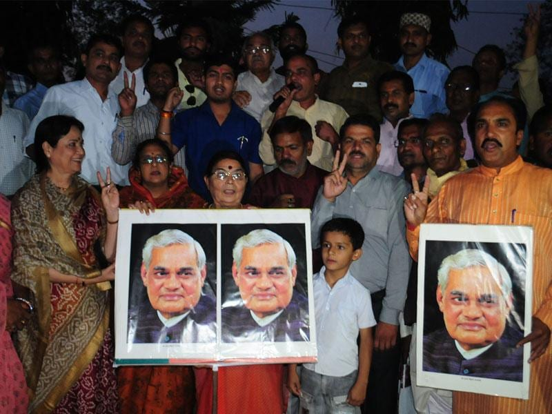 BJP workers celebrate Bharat Ratna for former Prime Minister Atal Bihari Vajpayee at state party headquarters in Bhopal on Friday. (Mujeeb Faruqui/HT photo)