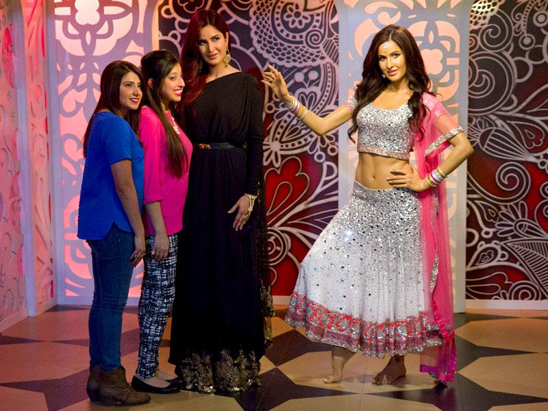Katrina Kaif poses with fans alongside her wax figure at Madame Tussauds in London, on March 27, 2015. (AFP Photo)