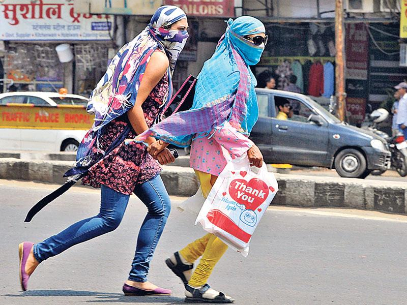 Girls use scarves to protect themselves from heat as day temperature rises in Bhopal. (Praveen Bajpai/HT photo)