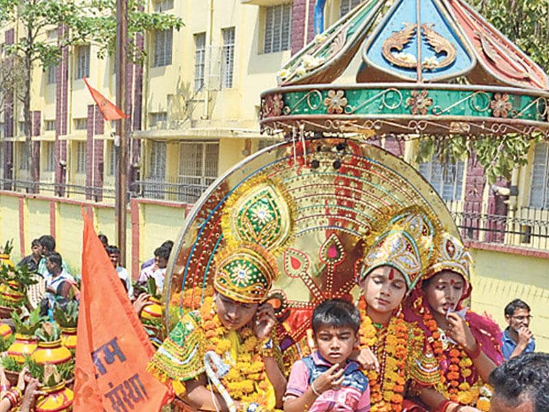 Devotees participate in a religious procession during Ram Navami celebrations in Bhopal on Saturday. (Bidesh Manna/HT photo)