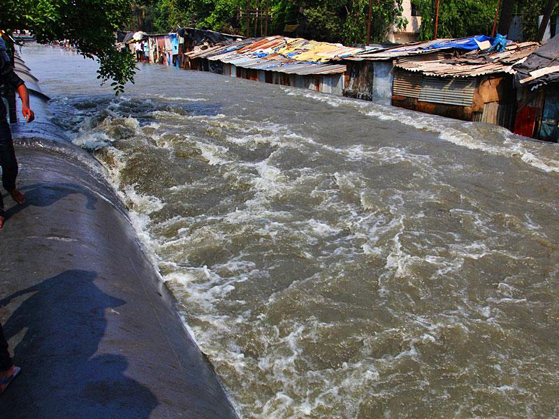 A BMC water pipeline passing through the Wagle Estate in Thane city burst, submerging several huts. (Photo credit: Praful Gangurde)
